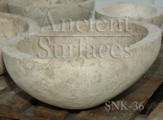 Half egg shaped limestone sink hand carved out of an antique limestone block