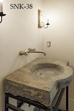 Antique reclaimed stone basin sink salvaged restored and installed in this traditional style Mediterranean home.