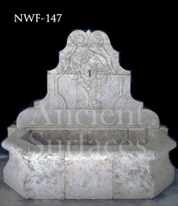 Hand carved stone wall fountain