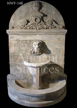 Hand carved lion stone wall fountain
